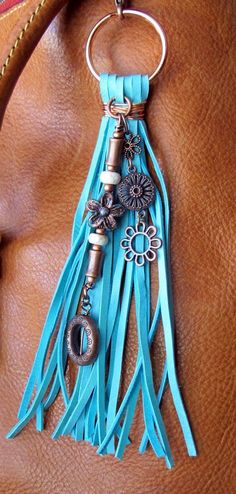 Design your own photo charms compatible with your pandora bracelets. ~ This handmade tassel charm can be used on your purse, backpack, zipper, wherever youd like to add some charm! Its made up of turquoise deerskin Tassel Jewelry, Leather Jewelry, Leather Craft, Beaded Jewelry, Handmade Jewelry, Jewellery, Leather Tassel, Bohemian Jewelry, Leather Cord