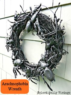 Grapevine wreath  *Krylon black spray paint (I used Chalkboard)  *Rubber spiders – dollar store  *Spray wreath with 2 or 3 coats of black Krylon spray paint  *Tuck one or two of each spider's legs under grapevine  *Hang and feel your skin crawl