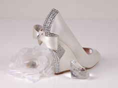 peep toe wedge wedding shoe in pearl pink with rhinestones and bow