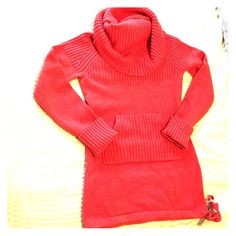 Coral sweater Coral sweater. Hits just below hips. Tie detail at bottom. Front pocket. Dramatic cowl neck can be warm in several drapes. Used. Anthropologie Sweaters Cowl & Turtlenecks