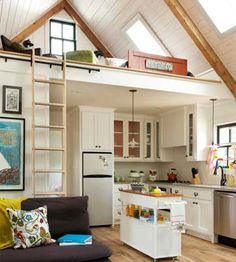 A tiny house kitchen that doesn't skimp on the amenities -- and makes very good use of every square inch, yet doesn't feel crowded.