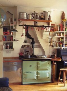 that stove - and a piano in the kitchen.