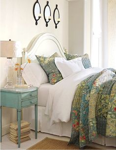 Cottage Bedroom: curvy white wood bed, layers of white bedding with quilt of soft blues & greens, antique-blue bedside table, and a glass lamp . so inviting. I am so liking this, our bed painted blue table. Home Bedroom, Bedroom Decor, Bedroom Ideas, Bedroom Modern, Design Bedroom, Master Bedrooms, Bedroom Colors, Master Suite, Wall Decor