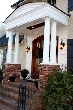 Portico-love double poles and brick, not that brick would really go with our house/.