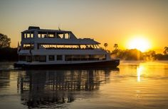Sit back and relax on this sunset cruise along the Zambezi River. See the wildlife whilst sipping on cocktails.In the evening you can join the sunset boat cruise upstream to see the setting of the African sun. Share the end-of-day ritual which sees w Victoria Falls, Autumn Activities, Africa Travel, Day Tours, Tourism, Cruise, National Parks, River, Zimbabwe