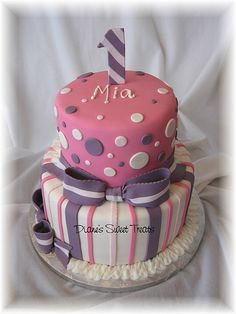Pink, gray, white stripes and dots cake.