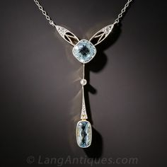 French Belle Epoque Aquamarine and Diamond Necklace. From turn-of-the-twentieth century France - a.k.a. La Belle Époque - (Edwardian on the continent) comes this ultra-fine and feminine necklace featuring a pair of refreshing pastel blue aquamarines. The sleek and slender design is delicately hand fabricated in platinum over 18K gold and accented with tiny rose-cut diamonds for a dash of twinkle.