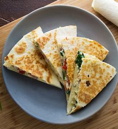 Up your meal prep game with some tasty spinach, feta, and egg quesadillas for next day breakfast. Store in the freezer, then pop them in the microwave when you're ready to eat. Go ahead girl, hit that snooze button!