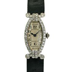 CARTIER PARIS Art Deco Diamond Watch  France  Deco  This a beautiful deco tonneau platinum and diamond Cartier ladies wristwatch from the 1930s.