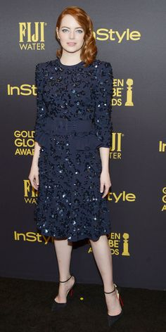 Look of the Day - Emma Stone wears a glittering navy Michael Kors Collection dress with a wide belt and black Christian Louboutin heels to the Instyle Golden Globes Party in West Hollywood.