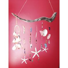 Beach vacation craft: driftwood, shells, and sea glass with wire wrapping = DIY light catcher/mobil