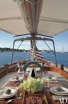 This wood-hulled vessel, hand built on Martha's Vineyard by Gannon & Benjamin Marine Railway, was outfitted by architects Peter Shelton and Lee F. Mindel of Shelton, Mindel & Assoc. Sail Away, Architectural Digest, Coastal Living, Outdoor Dining, The Hamptons, Life Is Good, Summertime, Table Settings, New England