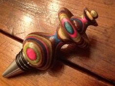 wood turned wine bottle stopper with stainless steel stopper on Etsy, $30.00