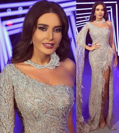 Cyrine Abdel Nour in silver evening dress with feather 💃