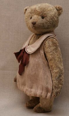 Teddy bear in striped dress by Hypatia.