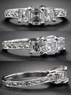 1.01 carat asscher cut diamond three stone ring. Via Diamonds in the Library.