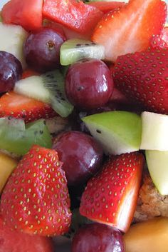 Sliced strawberries, green apple chunks, red grapes, and sliced kiwi ~ 15 Irresistible Fresh Fruit Salads ... #holiday #favorite