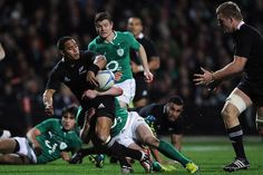 All Blacks humiliate Ireland 23 June 2012.  Aaron Smith of the All Blacks offloads. Photo: Getty Images