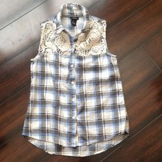 Rue 21 Sleeveless Buttondown Beautiful plaid sleeveless button-down from Rue 21. Purchased and never wore it! Excellent condition with no holes, stains, or tears. Smoke free home. Rue 21 Tops Button Down Shirts