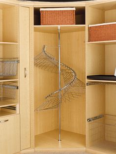 """Break away from the ordinary with Rev-A-Shelf's Spiral Clothes Rack. This perfect corner closet solution has a 360-degree turning radius with an adjustable height of 72-1/2"""" to 84"""" and the ability to hang 40 single items of clothing (long, medium, and short hanging) from top to bottom. The SHR-84 comes complete with a stabilizer bar, post and pivot hardware, and mounting hardware."""