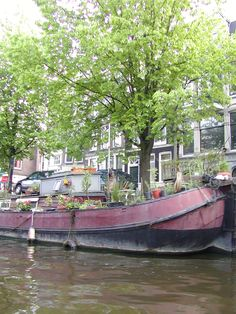 an old barge converted into a house..  Amsterdam canal  by jadoretotravel