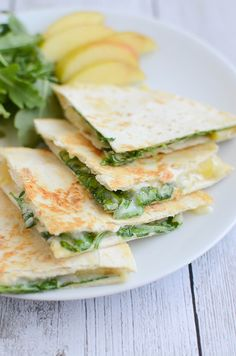Apple and Brie Quesadillas with arugula and apple cider mustard. You won't believe how delicious this combo is!