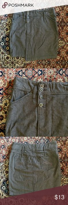 Tommy Hilfiger Denim Skirt Tommy Hilfiger Gray Denim Skirt.  Lightly used!  In great condition. Has super cute buttons down the front and pockets in the back! Tommy Hilfiger Skirts