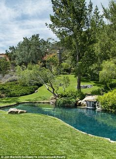 A waterfall design element in included in the pool belonging to the Hollywood A-lister...