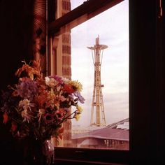 a view of the Space Needle getting its top during construction, Seattle, WA, 1961