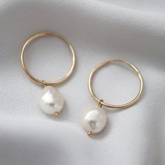 These freshwater pearl drop hoops are delicate, minimal and just perfect! Theyre available in gold filled or sterling silver - durable materials perfect for everyday wear :) Gold Hoop Earrings, Bridal Earrings, Women's Earrings, Bridal Jewelry, Gold Hoops, Pearl Jewelry, Gold Jewelry, Jewelry Accessories, Punk Jewelry