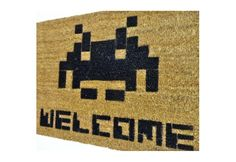 Defend your home from unwelcome visitors with this Space Invader Welcome Mat