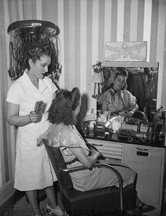 I love shots like this from the 40s that show the inner going ons of mid-century beauty parlors.