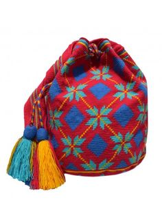 These fabulous woven bags are handcrafted by the Wayuu people, an ethnic group of the Guajira peninsula in northern Colombia. Shop Mochilas Wayuu Bags with Across the Puddle