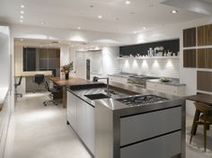 Roundhouse Fulham showroom featuring Urbo island with Wenge breakfast bar and stainless steel worktops