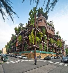 "Treehouse apartments in Turin, Italy. Designed by architect Luciano Pia, the apartment building is called 25 Verde (which translates to ""25 Green""). Standing five stories high with 63 rooms, the building lives up to its moniker and looks like a giant, beautiful forest."