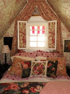 Darling bedroom under the eaves. Great idea of toille pattern in shutters and drapes in another pattern.