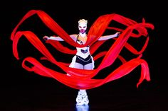 Dancer with red ribbon in UV light. Anta Agni - Crystal Light Show