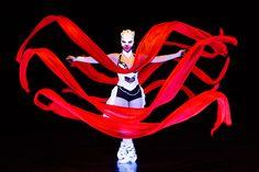 Dancer with red ribbon in UV light. Anta Agni - Crystal Light Show. http://antaagni.com/crystal-light-show/