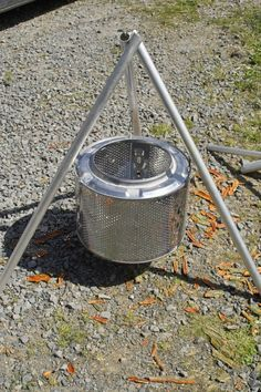 Portable firepit made out of an old washing machine drum! GENIUS! Not to mention freakin' awesome for the beach