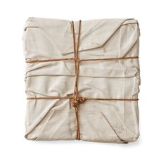 """Christo Vladimirov Javacheff [Bulgaria] (b 1935) ~ """"Wrapped Book"""", 1973. The Book """"Christo"""" wrapped in canvas and with twine (31 x 28 cm) 