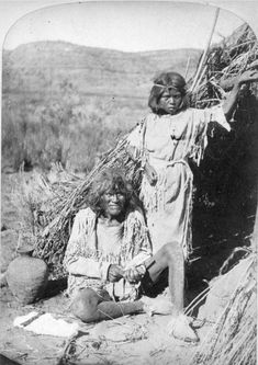 """thebigkelu: """"Native American (Paiute) man and girl pose in front of a wickiup on the Kaibab Plateau in northern Arizona. - Hillers - 1874 """""""