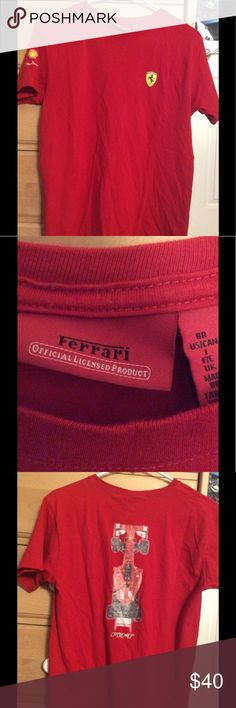Authentic Ferrari Apparel Racing T-Shirt Authentic Ferrari Apparel T-Shirt  Size Men's Small, could fit a Women's Medium or Large  In great shape, pre-owned but no obvious signs of wear - stains, holes or fading  Ferrari is the coolest car brand out there  Own a dope car shirt today! Ferrari Shirts Tees - Short Sleeve