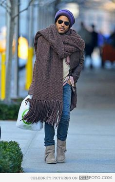 the man even makes wearing a blanket/scarf and boots look good!