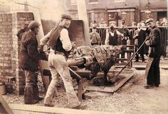 Ox Roasting on 9 Aug 1902 for King Edward VII Coronation Image courtesy of Surrey Libraries and is held in the Epsom & Ewell Local And Family History Centre
