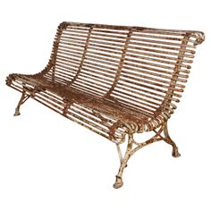 French iron bench by Arras, circa 1900. Charming chipped paint with  manufactuer's tag | From a unique collection of antique and modern benches at http://www.1stdibs.com/furniture/seating/benches/