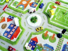 We are pleased to introduce a new range of 3 dimensional Play Rugs for children of all agesThis fun rug is available in green or blue, complete with soccer field, school and a big car park. Note how the road is without pile, and hence, easier for