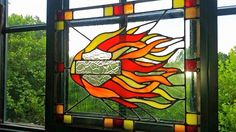 Original Harley Logo stained glass piece with flames designed and made for a friend