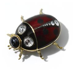 A Fabergé gold, jewelled and enamel brooch, workmaster Oscar Phil, Moscow, circa 1890, in the form of a ladybird, the body decorated in red guilloché enamel with black dots, set on the body and legs with circular and rose-cut diamonds, the head mounted with a sapphire.