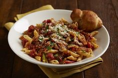 Italiano Vegetable Penne - Penne pasta with sautéed bell peppers, onions, garlic and seasoned tomatoes tossed with our marinara and finished with Parmesan chees and fresh basil.