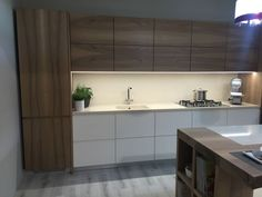 Brown wood and white kithcen layout